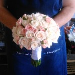 Pretty pink and champagne hand tied bridal bouquet
