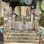 Blue and White Flowers at a Lychgate