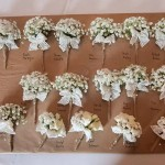 Gypsophila and lace buttonholes